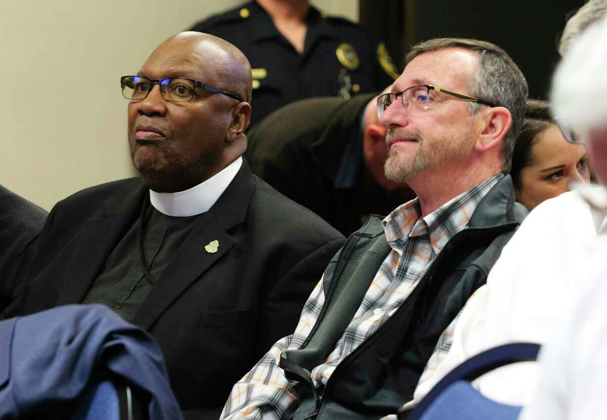 Bishop Grady Morris (left) and Harold Arant of VisionQuest Texas chat as Universal City's City Council gathers to discuss and potentially vote on a zoning request by New Covenant Church, which is looking to lease with VisionQuest to house up to 60 migrant boys at a vacant school building in the San Antonio suburb on Tuesday, Jan. 21, 2020.