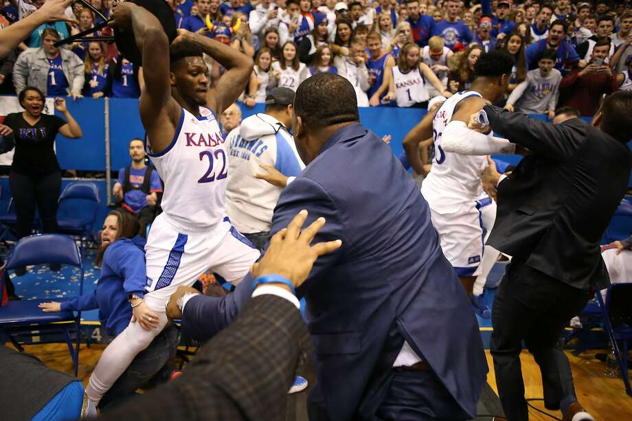 Kansas' Silvio De Sousa (22) picks up a stool during a brawl near the end of the Wildcats' win over Kansas State. Photo: Jamie Squire / Getty Images