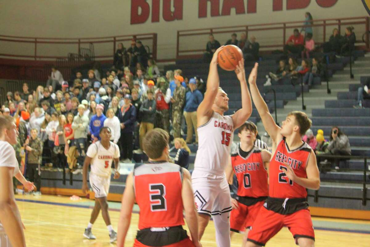 Reed City's ChazDavistries to block Big Rapids' LJ Graves from the basket in Friday action. (Herald Review photo/John Raffel)