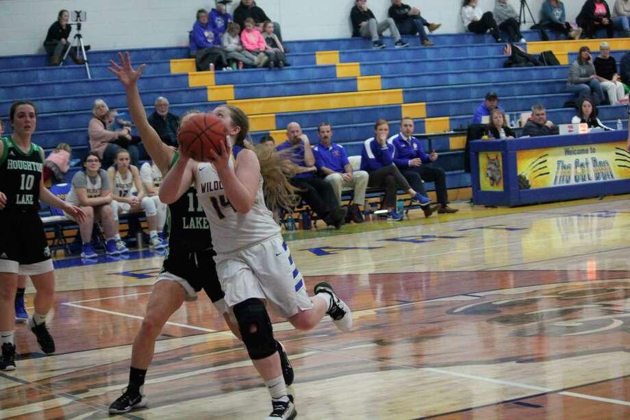 Evart's Madison Parrish goes to the basket against Houghton Lake. (Herald Review photo/John Raffel)