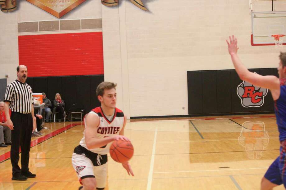Reed City's Logan Hansen gets set to drive against Chippewa Hills on Jan. 14. (Herald Review/John Raffel)
