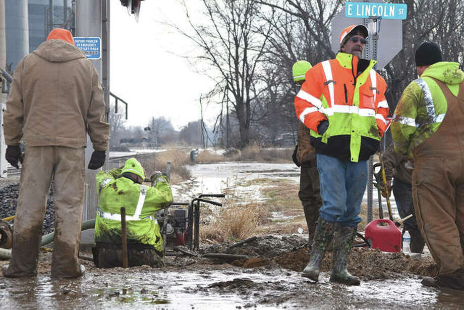 Crews from White Hall and Roodhouse utility departments work Tuesday to fix a broke water main that has shut down water to the community twice since Sunday.