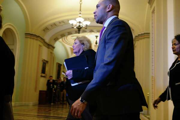 The House managers for the impeachment trial walk in the Capitol on Tuesday. From right to left are Reps. Zoe Lofgren, D-Calif., Hakeem Jeffries, D-N.Y., and Val Demings, D-Fla.