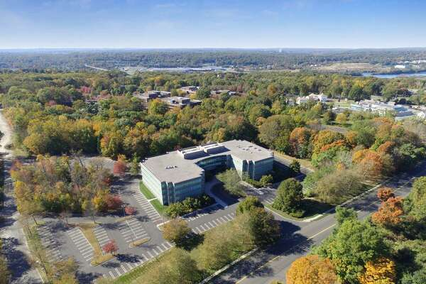 An aerial view of 440 Wheelers Farms Road in Milford. A Stamford real estate investment firm has acquired the former Merritt Crossing office complex and will begin renovating it later this month.