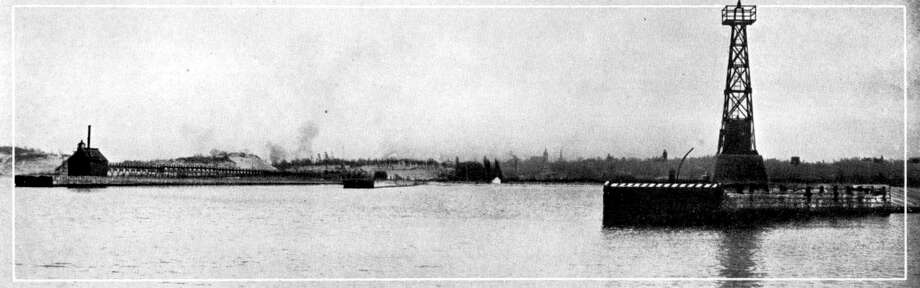 The entrance to the Manistee Harbor looked much different in the 1890s with the lighthouse that was located there at the time.