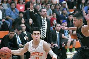 Alex Idrogo controls the ball for the United Longhorns as Jacob Treviño defends for the United South Panthers Tuesday, January 14, 2020 at the United High School Gym.