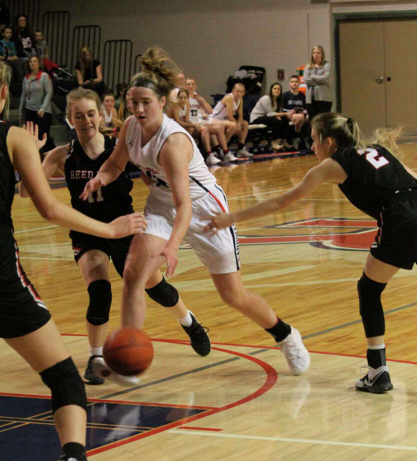 Reed City's Paige Lofquist (left) goes after the ball against Big Rapids on Friday in CSAA action. Photo: Herald Review Photo/John Raffel