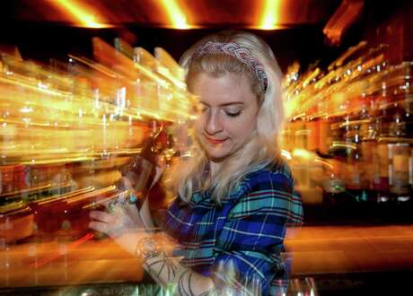 Bartender Becca Yannone prepares a cocktail inside Capt. Foxheart's Bad News Bar & Spirit Lodge Thursday, Jan. 16, 2020. The bar is one of several speakeasies around the city.