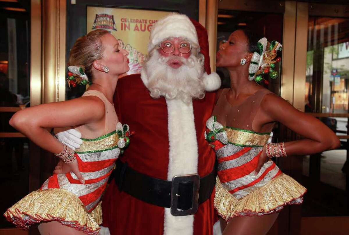 NEW YORK - AUGUST 12: The Radio City Rockettes and Santa Claus (Center) pose for photos during the 2010 Radio City Christmas Spectacular Kick-Off at Radio City Music Hall on August 12, 2010 in New York City. (Photo by Astrid Stawiarz/Getty Images)