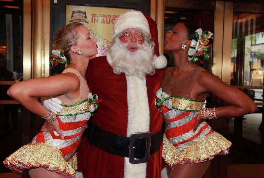 NEW YORK - AUGUST 12:  The Radio City Rockettes and Santa Claus (Center) pose for photos during the 2010 Radio City Christmas Spectacular Kick-Off at Radio City Music Hall on August 12, 2010 in New York City.  (Photo by Astrid Stawiarz/Getty Images) Photo: Astrid Stawiarz, Getty Images / 2010 Getty Images