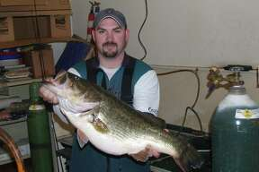 Ricky Beardan II holds the record largemouth bass for Lake Conroe. He caught it Jan. 30, 2009, and it weighed 15.93 pounds.