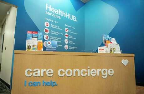 "The care concierge table at CVS's Minute Clinic ""health hub"" in the Galleria area of Houston on Monday, Jan. 13, 2020."