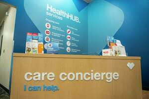 """The care concierge table at CVS's Minute Clinic """"health hub"""" in the Galleria area of Houston on Monday, Jan. 13, 2020."""