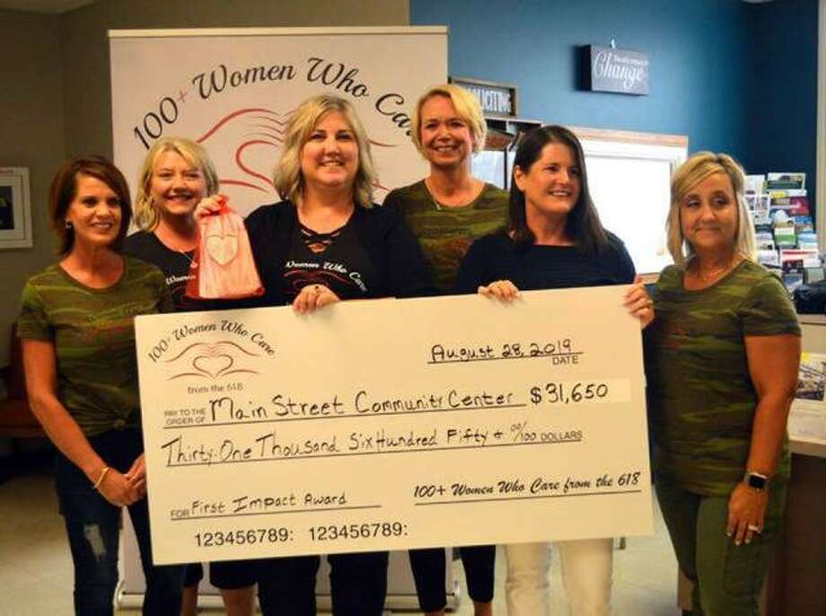 In this August 2019 file photo, officers and board members from 100+ Plus Women Who Care from the 618 present a check for $31,650 to Main Street Community from its first quarterly impact meeting. Photo: Scott Marion | The Intelligencer