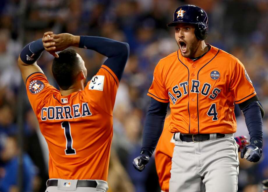 George Springer #4 of the Houston Astros celebrates with Carlos Correa #1 after hitting a two-run home run during the second inning against the Los Angeles Dodgers in game seven of the 2017 World Series at Dodger Stadium on November 1, 2017 in Los Angeles, California. Photo: Ezra Shaw/Getty Images