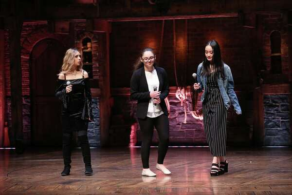 "From left, East Haven High School juniors Krystal Luna, Bianca Apuzzo and Christy Le perform their original three-part poem on the stage of the Richard Rodgers Theater on Broadway prior to an afternoon matinee of ""Hamilton."""