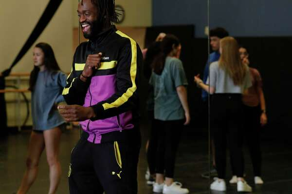 Stephane Fiossonangaye, a professional Cirque du Soleil dancer, shares a laugh as he works with students in their aerial arts class at The John Cooper School, Tuesday, Jan. 21, 2020, in The Woodlands.