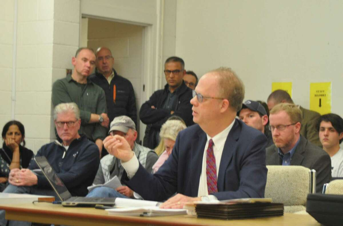 A room packed with Turner Hill area neighbors listened as attorney Brian Smith described plans for a nine-unit affordable housing project on just over an acre at the intersection of Turner Road and Barnum Place.