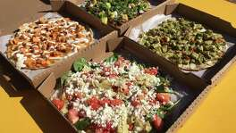 A selection of pizzas from Bob & Timmy's on Wheels includes, clockwise from top left, a buffalo chicken, al pastor, pesto and veggie medley.