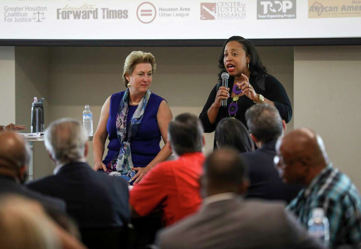 Carvana Cloud, right, former chief of the Harris County District Attorney's Office Special Victims Bureau, and Harris County District Attorney Kim Ogg, spoke together about domestic violence and homicides during a community meeting on Saturday, Aug. 10, 2019, in Houston. Cloud is now running against Ogg in the Democratic primary for district attorney.
