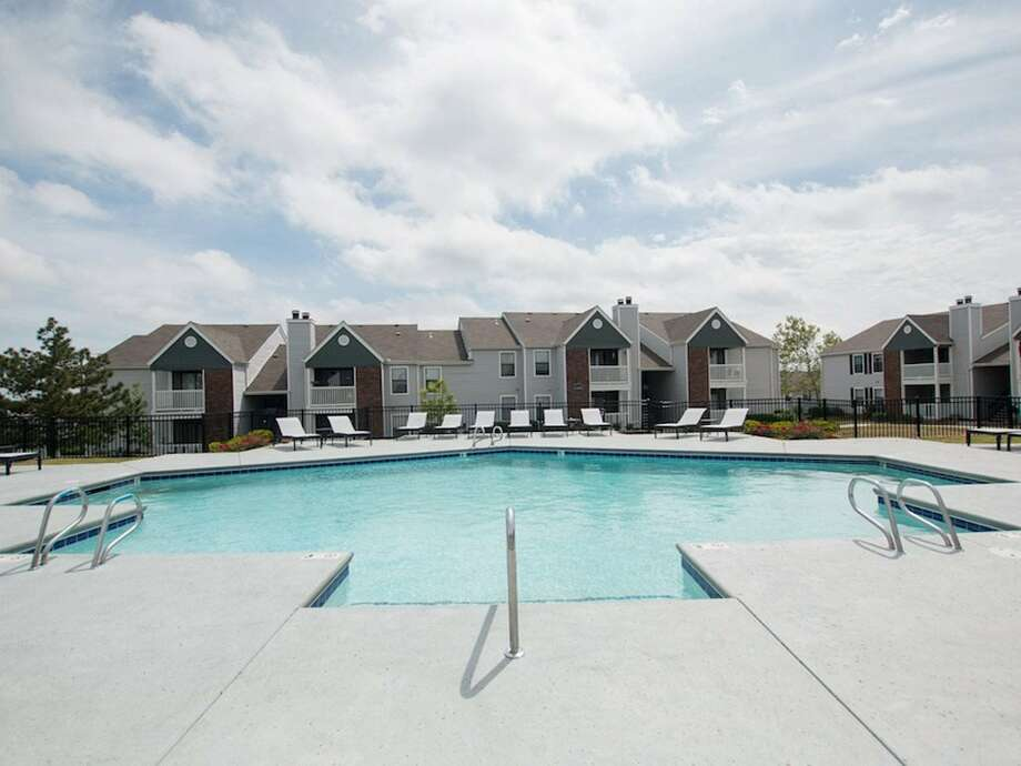The Wisconsin-based commercial real estate investor MLG Capital acquired 10 apartment complexes in Texas and Oklahoma. The developments were built in the 1970s and '80s and charge relatively affordable rents due to their age. Pictured is one of the acquired complexes in Tulsa, Oklahoma. Photo: CBRE