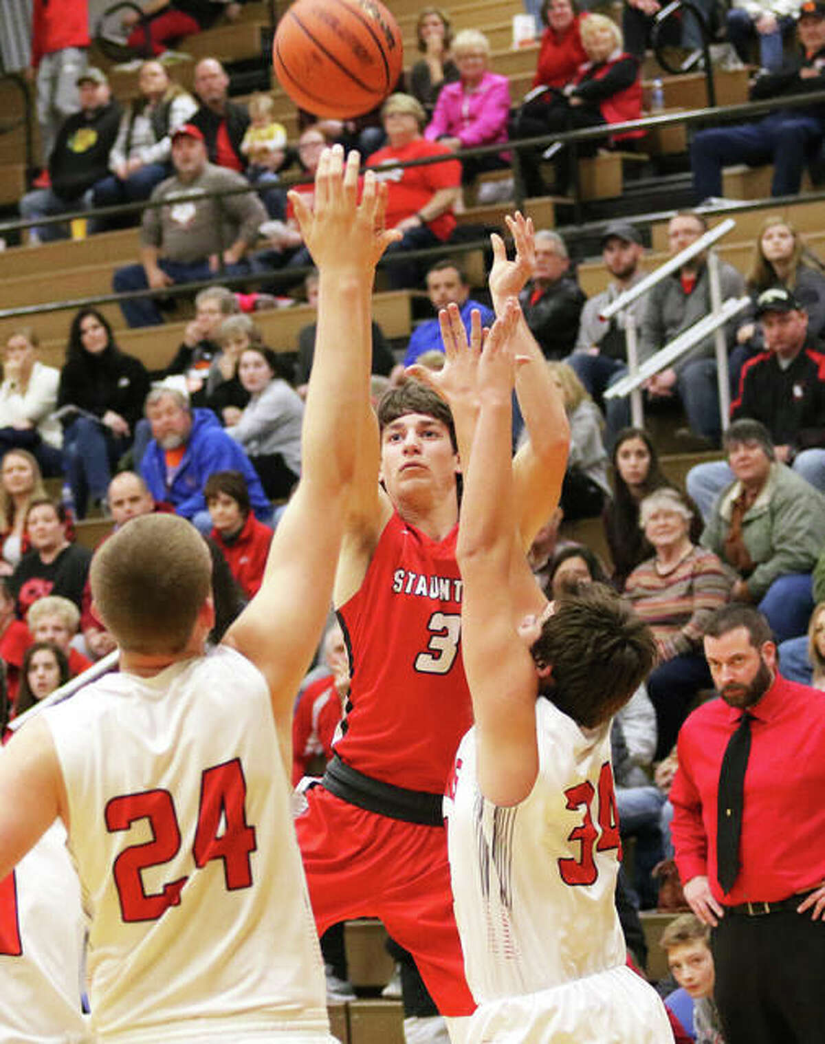 Staunton's Brent Kinder (3), shown shooting over Calhoun's Ben Eberlin (24) and Brody Caselton in the title game at the Carlinville Tourney on Dec. 30, scored 14 points in a win over Mount Olive on Tuesday night in the Macoupin County Tourney in Staunton.
