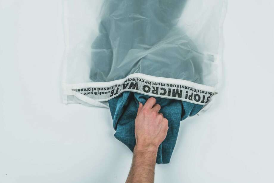The Guppyfriend Washing Bag is designed to filter out microfibers released by textiles during washing to prevent plastic pollution. Photo: Guppyfriend / The Washington Post