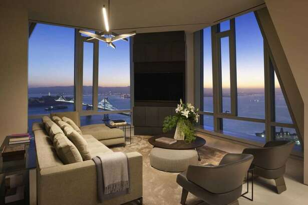 The grand penthouse family room at 181 Fremont enjoys floor-to-ceiling windows and sweeping views.