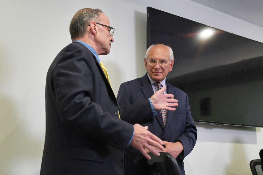 Stuart Rosenblatt, left, executive director of New Choices Recovery Center talks with Congressman Paul Tonko on Tuesday, Aug. 27, 2019, in Schenectady, N.Y. (Paul Buckowski/Times Union)