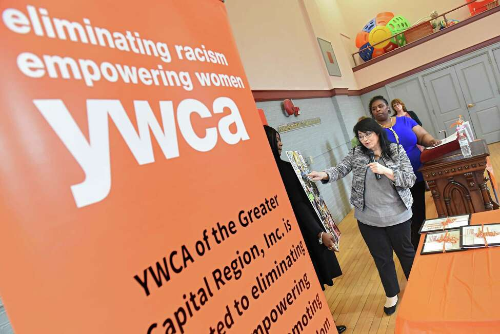 Carol Pave points to an inspiration board she made during a ceremony honoring graduates who have completed a twelve-week skills based program where they learned the fundamentals of securing and maintaining a livable wage job at the YWCA of the Greater Capital Region on Friday, April 7, 2017 in Troy, N.Y. (Lori Van Buren / Times Union)