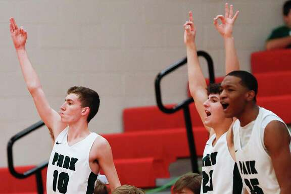 Kingwood Park players react after a 3-pointer during the second quarter of a high school basketball game at the Splendora Invitational, Saturday, Dec. 7, 2019, in Splendora.