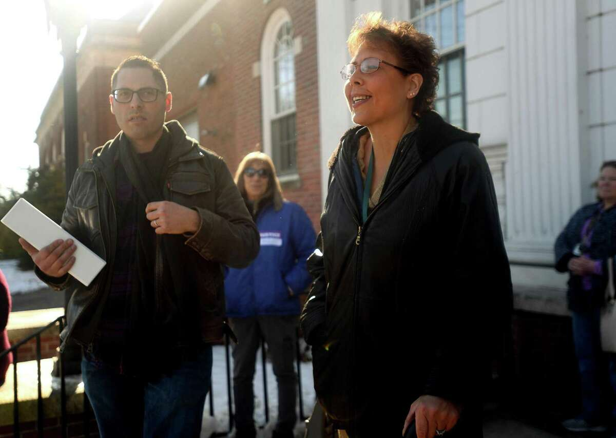 Standing with her brother, Tim McLaughlin, Lori Wierzbicki, of Milford, smiles as she addresses supporters and the media outside Superior Court in Milford, Conn. on Wednesday January 21, 2020. Judge Peter Brown threw out the plea deal for Russell Molleaur after Wierzbicki delivered her victim's statement.