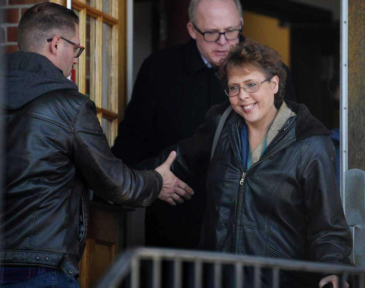 Lori Wierzbicki, of Milford, smiles as she exits Superior Court in Milford, Conn. on Wednesday January 21, 2020. Judge Peter Brown threw out the plea deal for Russell Molleaur after Wierzbicki delivered her victim's statement in the assault case.