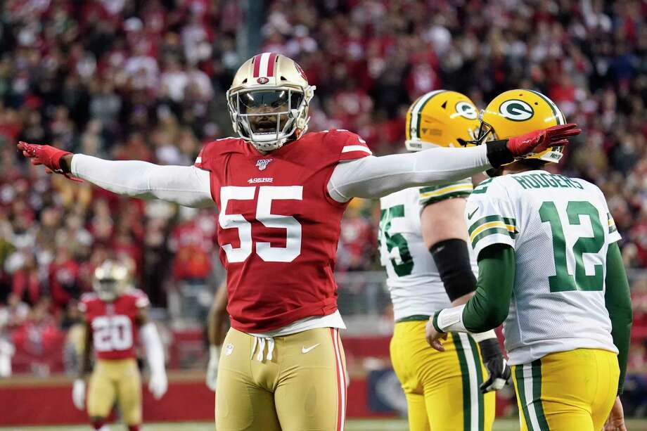 San Francisco 49ers defensive end Dee Ford (55) gestures next to Green Bay Packers quarterback Aaron Rodgers (12) during the first half of the NFL NFC Championship football game Sunday, Jan. 19, 2020, in Santa Clara, Calif. Photo: Tony Avelar, AP / Copyright 2020 The Associated Press. All rights reserved