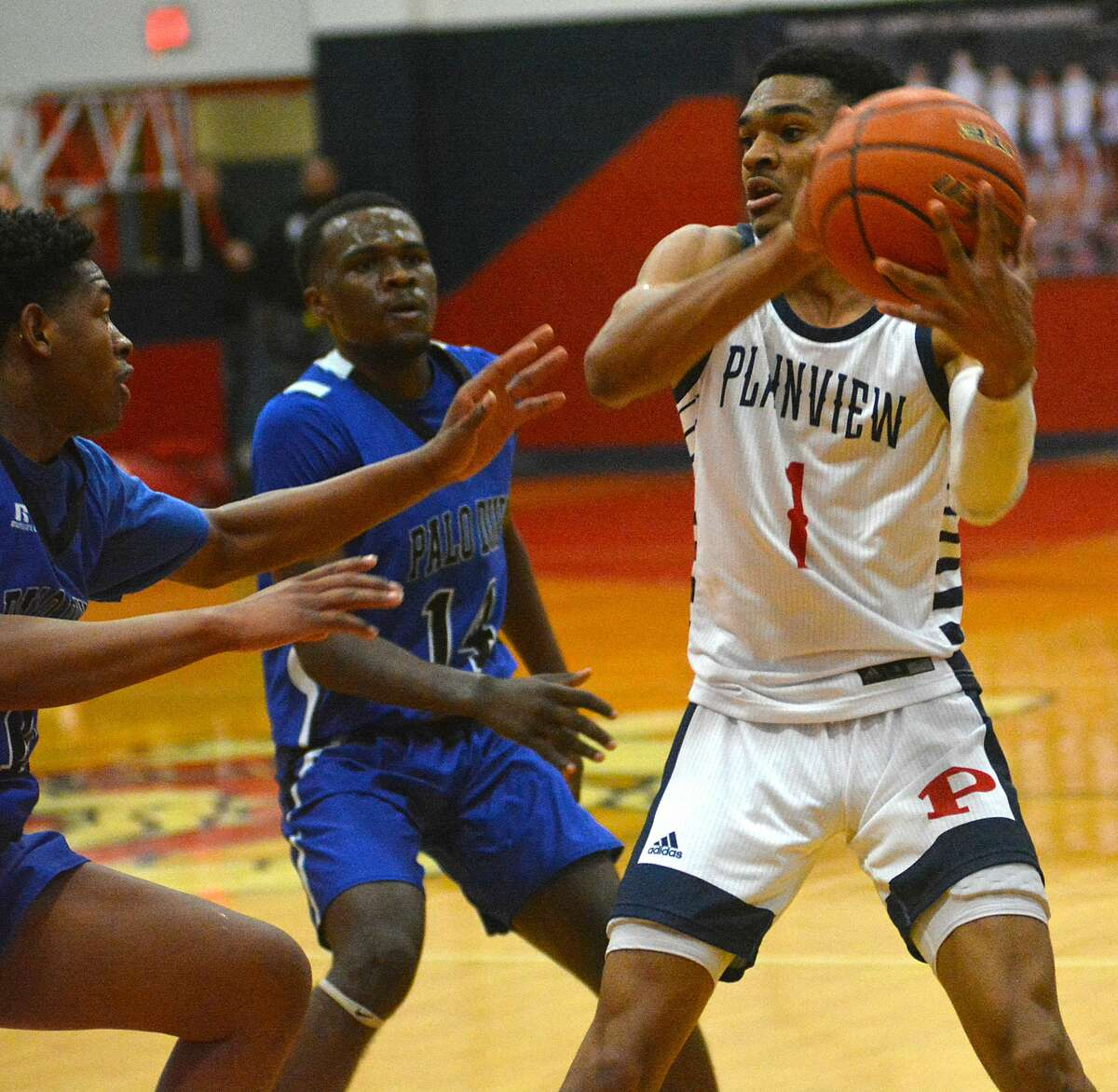 Plainview's Ryan Jackson tries to pass out of a double team against Amarillo Palo Duro in a District 3-5A boys basketball game on Tuesday in the Dog House.