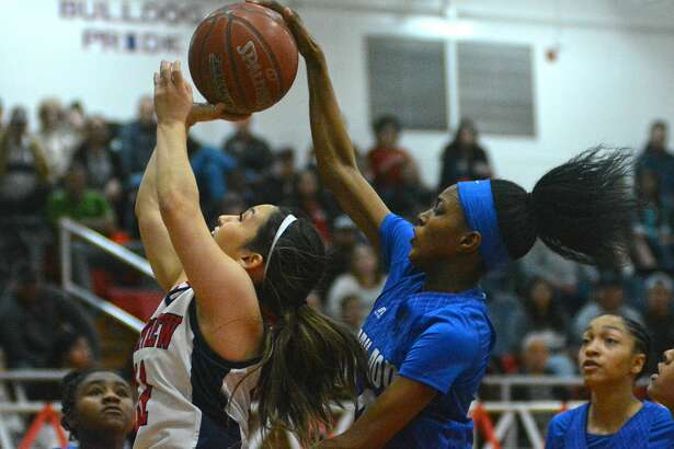 Plainview's Emily Sigala has her shot blocked by Amarillo Palo Duro's Sh'heneci Matthews during their District 3-5A girls basketball game on Tuesday in the Dog House.