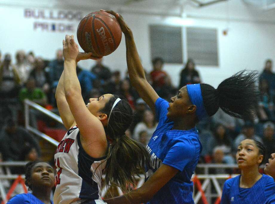 Plainview's Emily Sigala has her shot blocked by Amarillo Palo Duro's Sh'heneci Matthews during their District 3-5A girls basketball game on Tuesday in the Dog House. Photo: Nathan Giese/Planview Herald