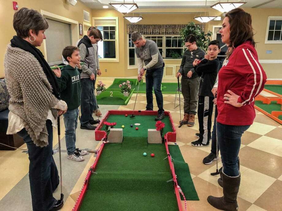 Families and friends at last year's event enjoying a round of indoor mini golf in Woodbury. Photo: Contributed Photo / ©2018 David Peter Arnold