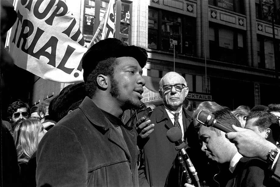 """FILE - In this Oct. 29, 1969, file photo, Fred Hampton, center, chairman of the Illinois Black Panther party, speaks outside a rally outside the U.S. Courthouse in Chicago while Dr. Benjamin Spock, background, listens. """"The First Rainbow Coalition,"""" a new PBS documentary, is exploring a little-known movement in 1960s Chicago that brought together blacks, Latinos, and poor whites from Appalachia that later resulted in the upending of politics in the American Midwest. (AP Photo/ESK, File) Photo: ESK, STF / Associated Press / 1969 AP"""