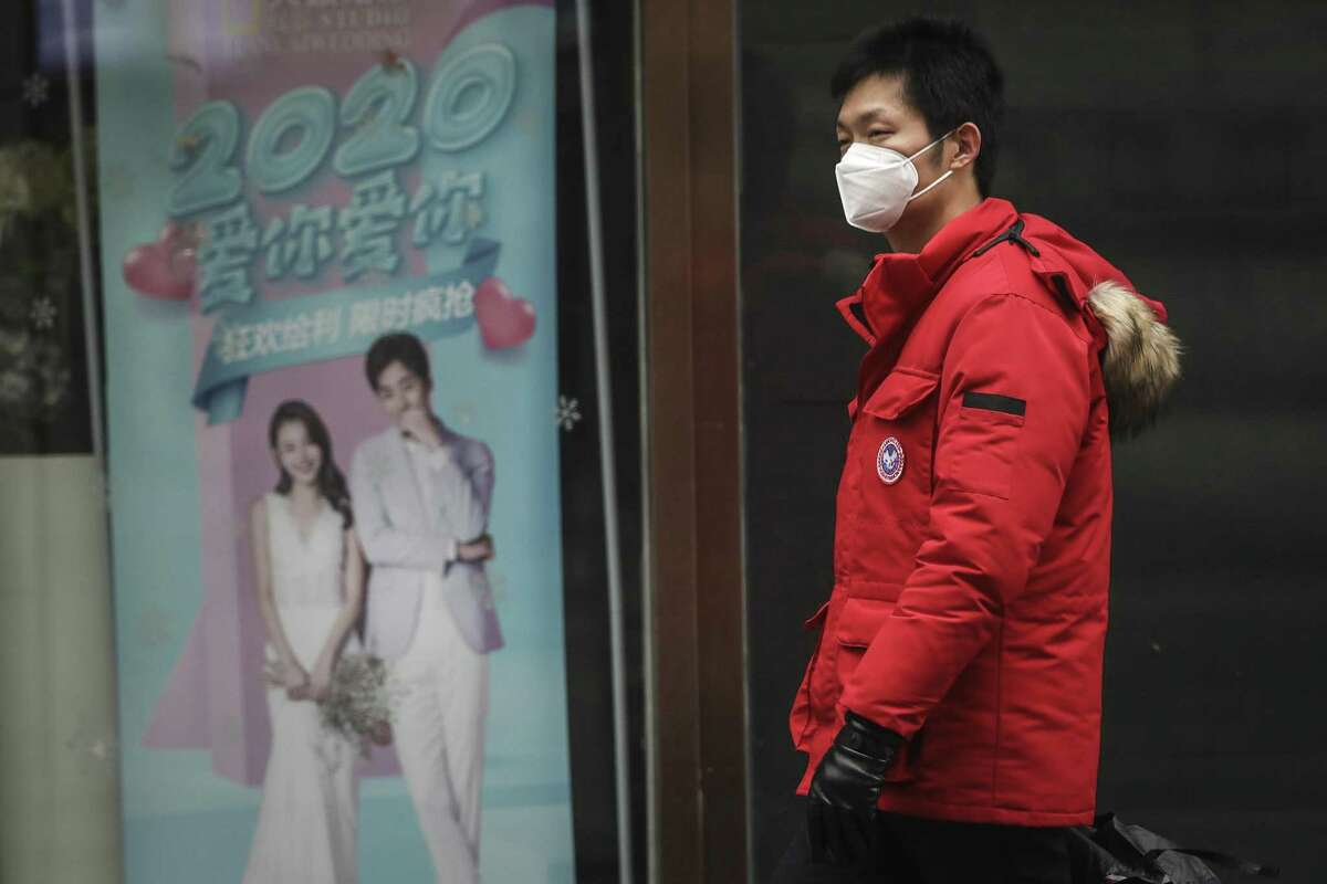 WUHAN, CHINA - JANUARY 22: (CHINA OUT) A man wears a mask while walking in the street on January 22, 2020 in Wuhan, Hubei province, China. A new infectious coronavirus known as