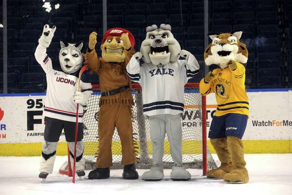 UConn's Johnathan the Husky, Sacred Heart's Big Red the Pioneer, Yale's Boola the Bulldog and Quinnipiac's Boomer the Bobcat, the four mascots from Connecticut universities participating in the Connecticut Ice gather on the ice at Webster Bank Arena, in Bridgeport, Conn. Dec. 16, 2019.