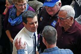 Democratic presidential candidate former South Bend, Ind., Mayor Pete Buttigieg, center, greets supporters following a town hall meeting at the University of Dubuque in Dubuque, Iowa, Wednesday, Jan. 22, 2020. (AP Photo/Gene J. Puskar)