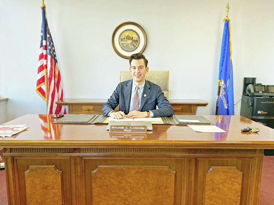 Middletown Mayor Ben Florsheim uses his new desk and chair, a gift from former mayor and common councilman Sebastian N. Giuliano, his political opponent during the November election. Photo: Contributed Photo