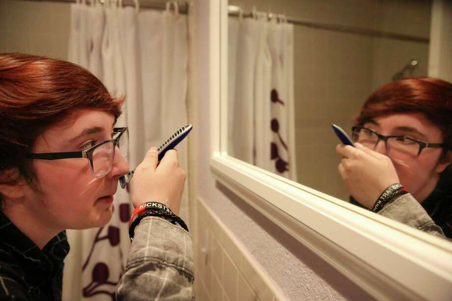Leon Burgher, 15, shaves to get ready for the prom hosted by Montrose Center's Hatch Youth, a group empowering LGBTQ youth from age 13 to 20, Thursday, June 1, 2017, in Houston. He accidentally cut his upper lip while shaving. Photo: Yi-Chin Lee,  Houston Chronicle / Staff Photographer / © 2017 Houston Chronicle