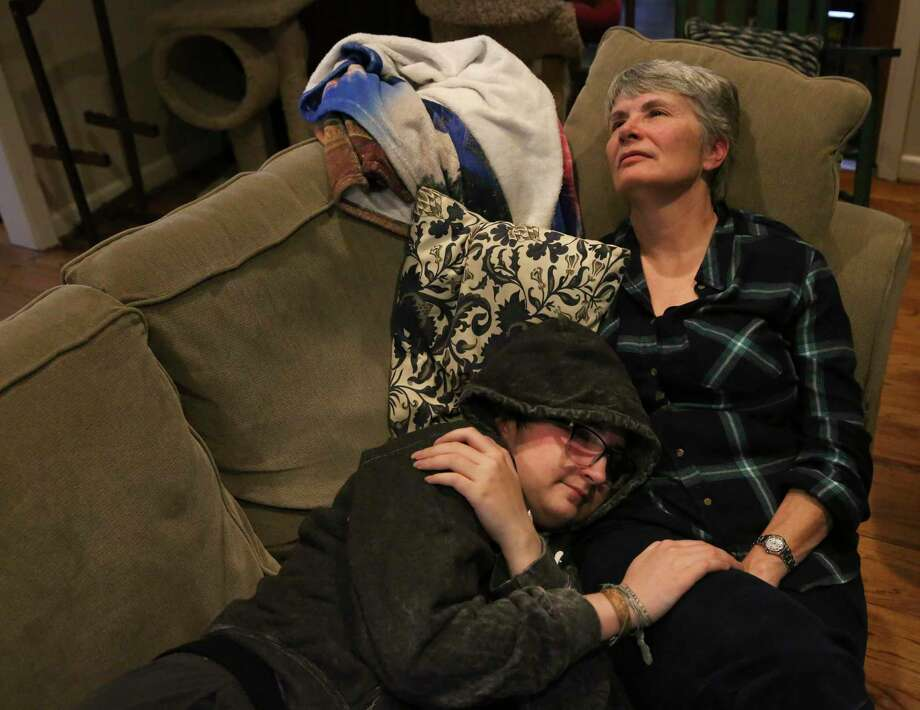 Leon Burgher, 16, and his mother, Mary Meyerson, reflect his life as the two lying on the couch Wednesday, March 14, 2018, in Houston. Meyerson said she notices Leon liked boys even when he was little. She thought she was raising a straight girl; instead, she was raising a boy who likes boys. Photo: Yi-Chin Lee,  Houston Chronicle / Staff Photographer / © 2018 Houston Chronicle