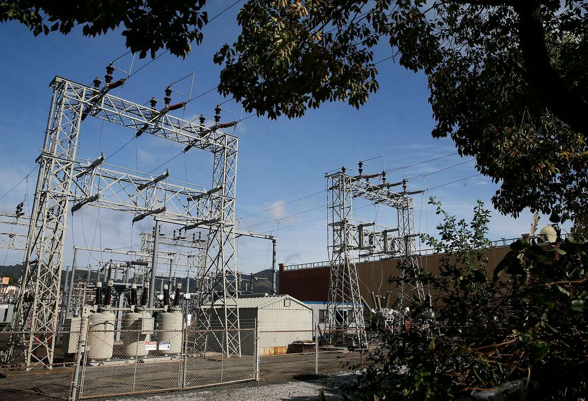 A PG&E substation in San Rafael. A new plan allows utilities to cut energy use in emergencies.