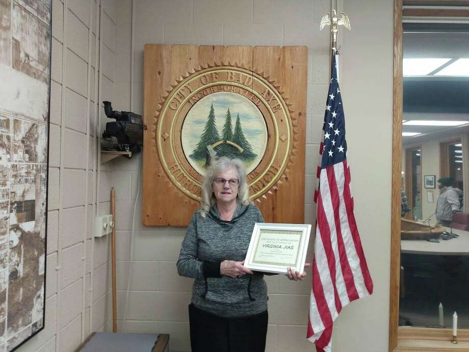 Virginia Jias accepts plaque of recognition for her time with Central Huron Ambulance Services. (Sara Eisinger/Huron Daily Tribune)