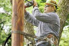 In this August 2016 file photo, an Ameren lineman drills into a pole.