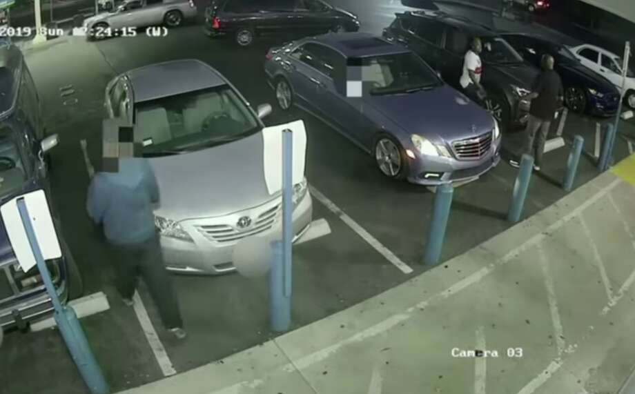 """A screenshot from a video released by the Vallejo Police Department shows off-duty Richmond police Sgt. Virgil Thomas in a confrontation with Eric """"Cheddaman"""" Reason, a man he shot and killed in a parking lot. Photo: Vallejo Police Department"""