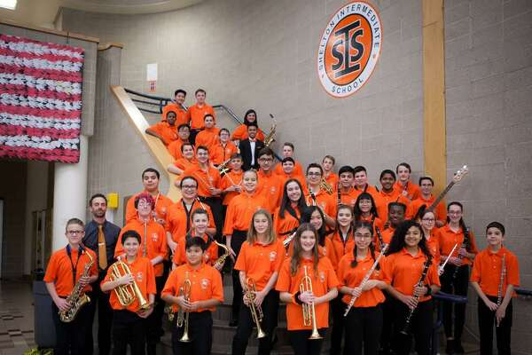 The Shelton Intermediate School Viking Band prior to performing Thursday during the SIS winter arts festival.